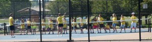 This drill featured 16 people at the net with racquets eager to hit volleys.